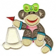 sandcastle_girl_sock_monkey